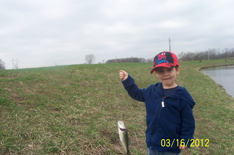 Duncan Showing His First Catch