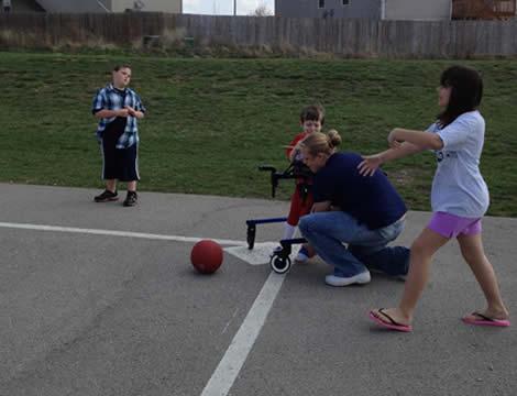 Parker Playing Kickball
